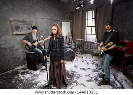 Rock band starts shooting video clip - stock photo