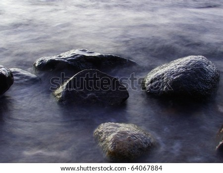 Rock boulders in water
