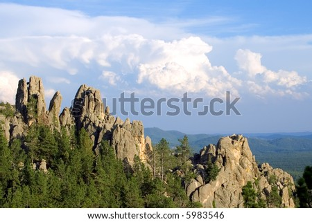 Rock cliffs and Fluffy Clouds
