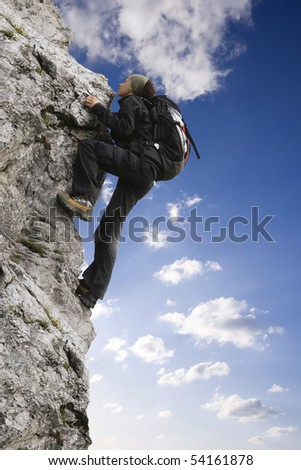 Rock climber - stock photo