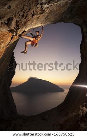 Rock climber at sunset. Kalymnos Island, Greece.  - stock photo