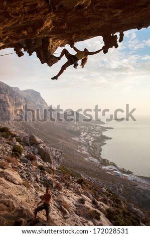 Rock climber at sunset, Kalymnos Island, Greece  - stock photo