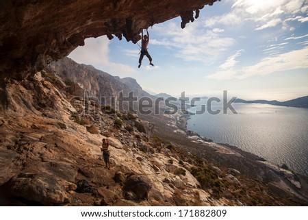 Rock climber climbing at the rock , Kalymnos Island, Greece  - stock photo