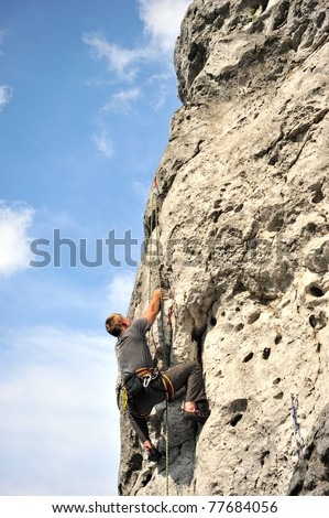 Rock climber climbing in Jura Plateau, Poland - stock photo