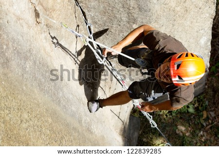 ROCK CLIMBER CLOSE UP, SHOOT FROM ABOVE  - stock photo