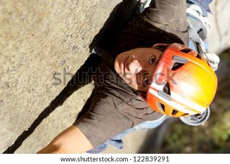 Rock climber closeup, shoot from above - stock photo