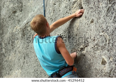 Rock climber. Dynamic composition. - stock photo