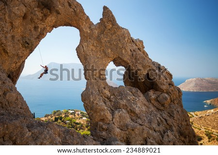 Rock climber falling of a cliff while lead climbing. Kalymnos Island, Greece   - stock photo