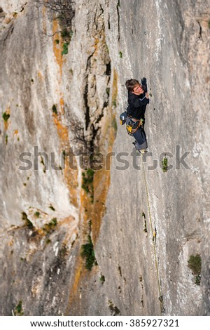 Rock climber on a rock. - stock photo