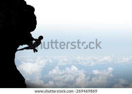 Rock climber on background of sunshine. Sport and active life - stock photo