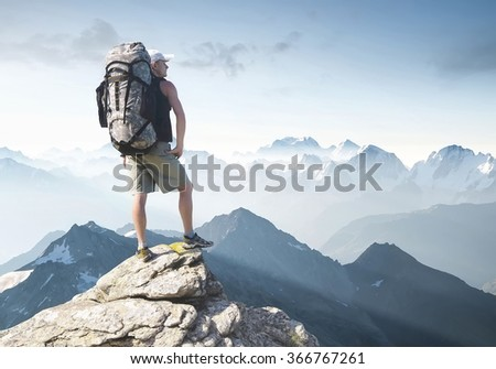 Rock climber on the peak. Sport and active life concept  - stock photo