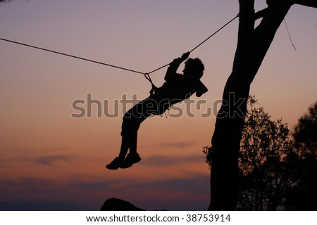 Rock climber rappelling - stock photo
