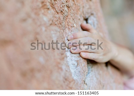 Rock climber's hand on handhold  - stock photo