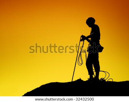 Rock Climber Silhouette - stock photo
