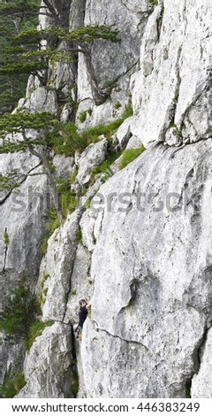 Rock  climber working his way up a cliff face. Peilstein, Austria. - stock photo
