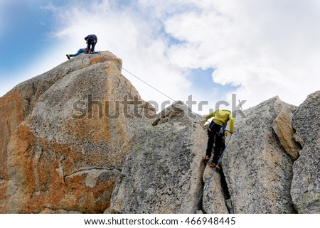 Rock climbing in the rock of Mont Blanc massif. Chamonix, France, Europe