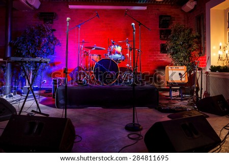 Rock concert stage with musical instruments in nightclub - stock photo