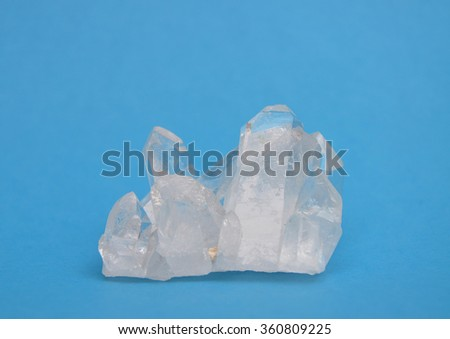 Rock crystal on blue - stock photo