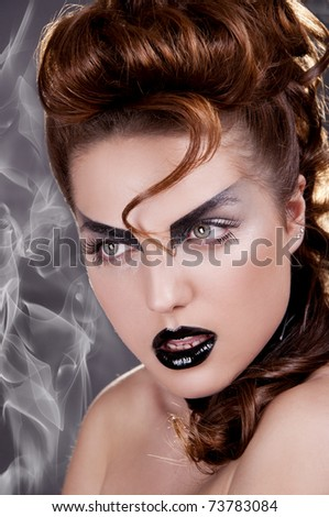 Rock diva, pretty woman with black make-up - stock photo