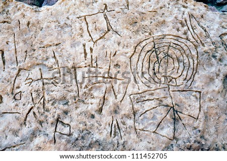 Rock drawings of carved stone in Timna Park, Israel. - stock photo