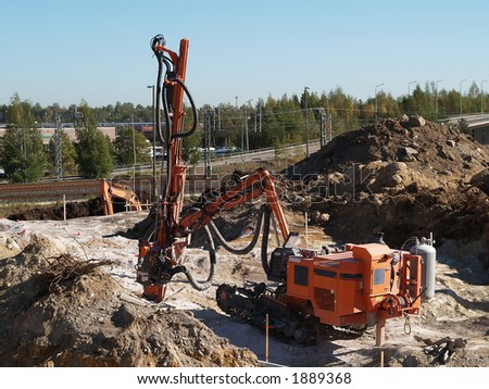 Rock drilling tractor on a rock, view - stock photo