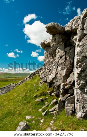 Rock face in North Yorkshire with blue sky and clouds