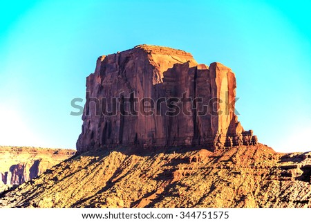 rock formations at sunset in Monument Valley, Utah - stock photo