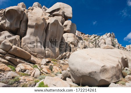 Rock formations in Capo Testa, Sardinia, Italy. Mediterranean coast.Natural monument. Sardinia nature with the space for advertising text,stones,rocks in blue clear sky background, summer in Sardinia  - stock photo