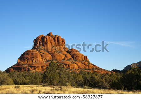Rock formations in the American Southwest against a blue sky - stock photo