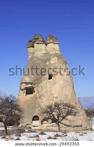 Rock Formations of Capadocia though erosion and weather make the rock look like Fairy Chimneys - stock photo