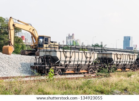 Rock freight train in the railway yard for maintenance the new railroad. - stock photo
