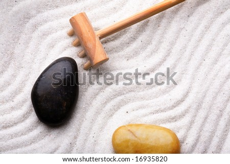 Rock garden background with rake, stones and sand
