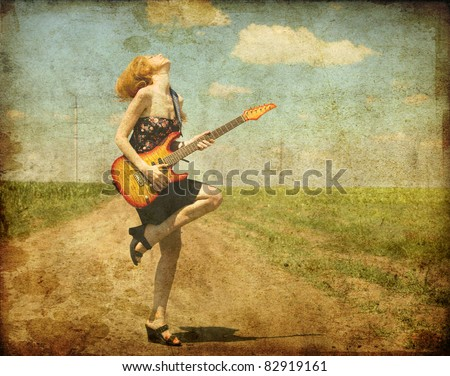 Rock girl with guitar at countryside. Photo in old color image style. - stock photo