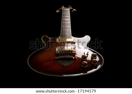 Rock guitar isolated on the black background. Shot in low key. - stock photo