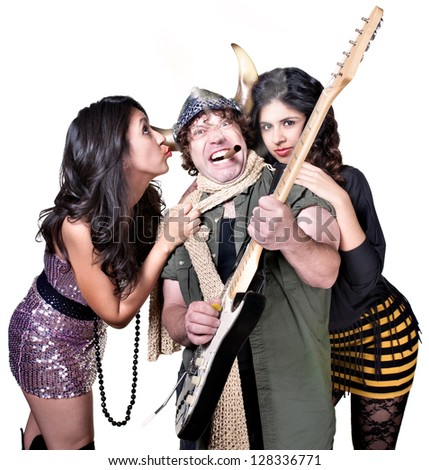 Rock guitar player with two beautiful female fans