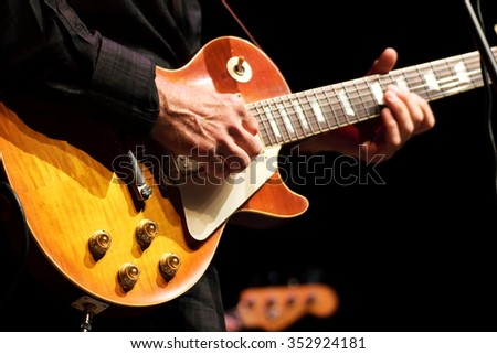 rock guitarist musician in concert - stock photo