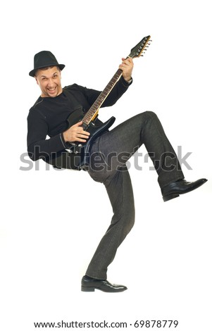 Rock guy with hat playing electronic guitar and lifting his leg isolated on white background