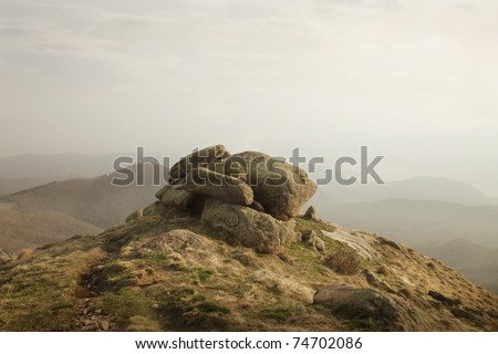 Rock in the mountains - stock photo