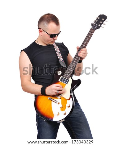 rock musician is playing electrical guitar - stock photo