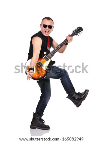 rock musician is playing on electrical guitar - stock photo