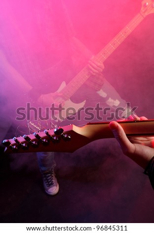 rock musicians playing at a live concert - stock photo