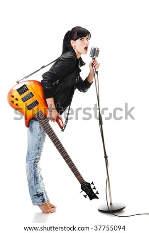 Rock-n-roll girl holding a guitar singing into retro microphone isolated on white