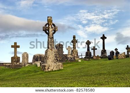 Rock of Cashel, Ireland - celtic crosses at graveyard - stock photo