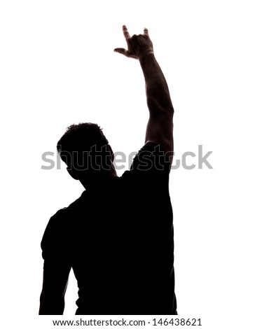 Rock on - in silhouette isolated over white background  - stock photo