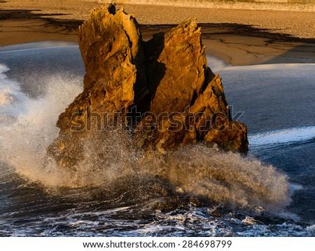 Rock on the beach in Biarritz - stock photo