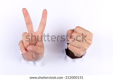 Rock paper and scissors hands gambling coming out from hole - stock photo