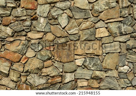 Rock pattern.A rock wall makes for interesting patterns. - stock photo