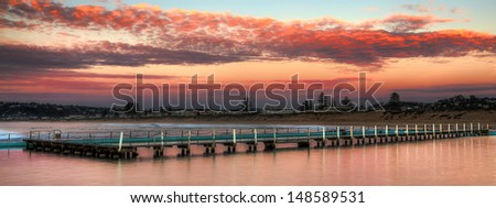 rock pool jetty at sunrise - stock photo