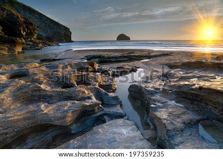 Rock pools at low tide on the beach at Trebarwith Strand on the north coast of Cornwall