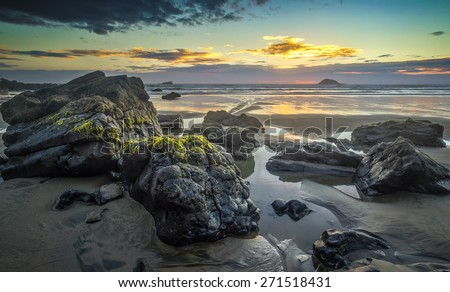 Rock pools, Maori Bay, Auckland New Zealand - stock photo